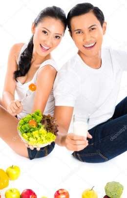 Asian couple eating salad fruit and vegetables