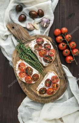 Sandwiches brushtta with roasted cherry tomatoes