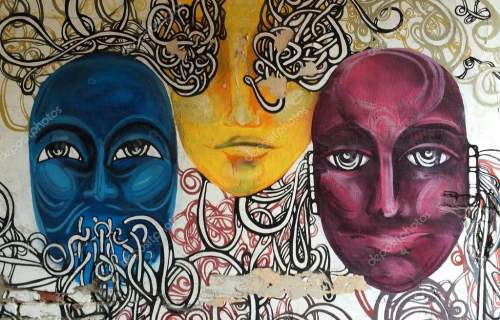 Graffiti of three colorful faces