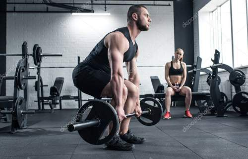 man doing strength training while woman sitting
