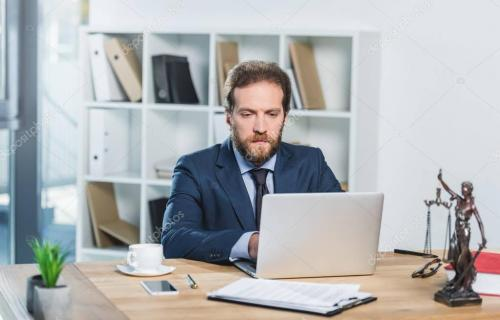 lawyer working on laptop in office
