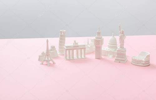 souvenirs from different countries on grey and pink