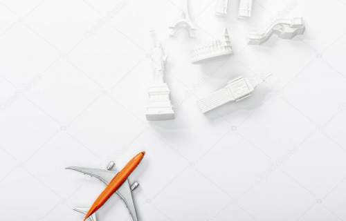 top view of small plane near figurines from different countries isolated on white