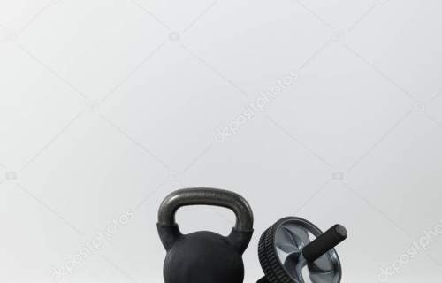step platform, dumbbells and kettlebell on floor at home