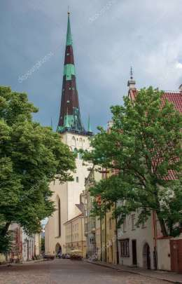 View on St. Olaf\'s Church with its picturesque streets in Tallinn\'s old town. The old medieval architecture of Estonia in the