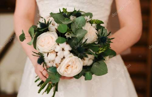 Bridal morning details. Wedding bouquet in the hands of the brid