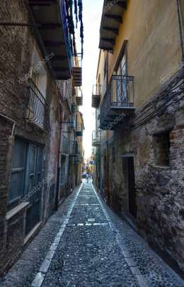 Cefal, Italy, Sicily August 16 2015. The alleys of cefal that wind at the foot of the fortress behind the cathedral. Steep stair