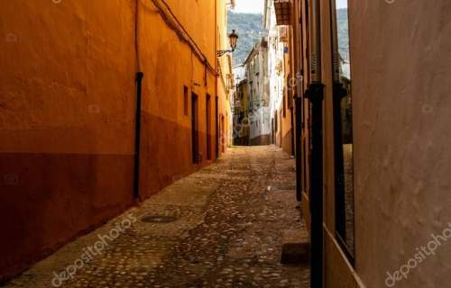 A vertical shot of an alleyway in Xativa, Spain