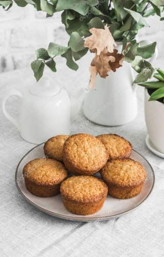 Simple almond muffins on the table. Cozy kitchen still life, dessert table