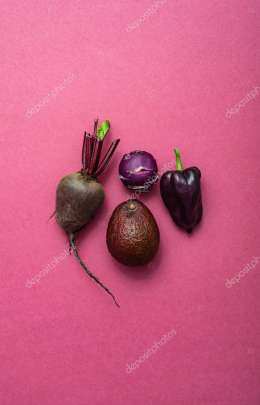fresh organic vegetables on the pink background