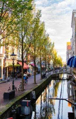 DELFT, THE NETHERLANDS - NOVEMBER 10, 2014 :On the streets of Dutch city. Canal in Delft, Netherlands