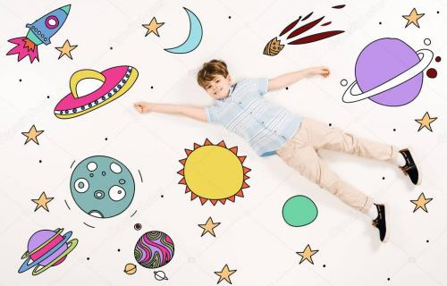 top view of cheerful kid flying in space on white