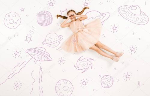 top view of cheerful kid in pink dress with hands near eyes in space on white
