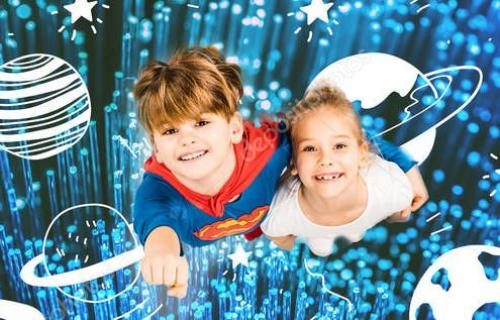 panoramic shot of cheerful kids flying is blue space on white