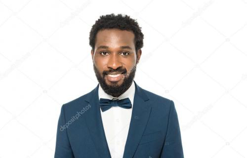 happy african american bridegroom smiling isolated on white