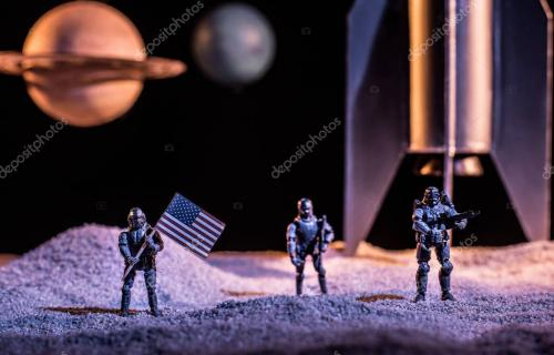 toy soldiers holding american flag in space near rocket and planets