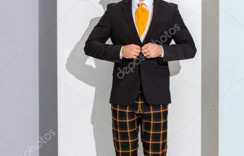 panoramic shot of stylish man touching formal wear on white and grey