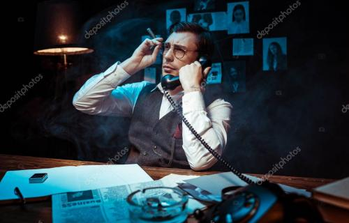 Detective in glasses holding cigar and talking on telephone in dark office