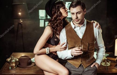 Sexy woman in black lingerie sitting on wooden table and flirting with detective in office