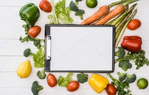 top view of fresh ripe vegetables and fruits near empty clipboard on wooden white background