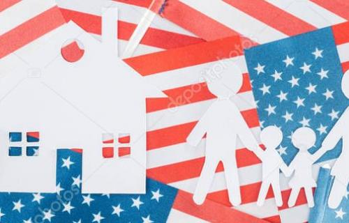 panoramic shot of white paper cut house and family on american flags background