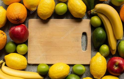 top view of tasty colorful fruits and wooden cutting board