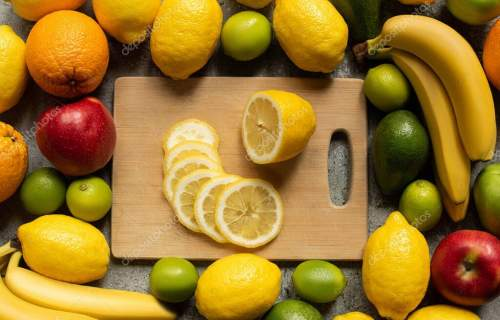 top view of tasty colorful fruits and wooden cutting board with lemon slices