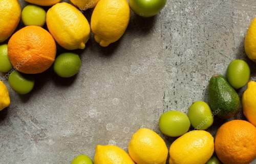 top view of colorful delicious fruits on grey concrete surface