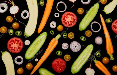 top view of fresh sliced vegetables isolated on black