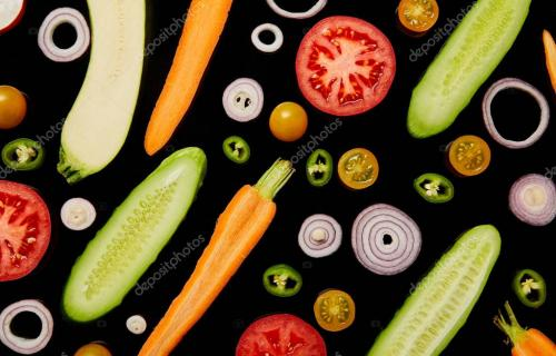 top view of fresh ripe tasty sliced vegetables isolated on black