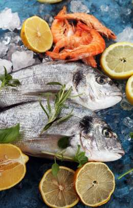 Delicious fresh fish. Fish with aromatic herbs, spices and vegetables - healthy food, diet or cooking concept