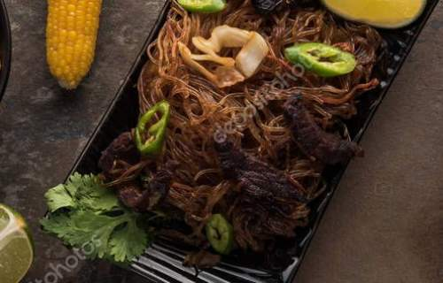 top view of delicious thai noodles with chopsticks on stone surface, panoramic shot