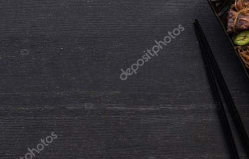 top view of meat thai noodles near chopsticks on wooden grey surface, panoramic shot